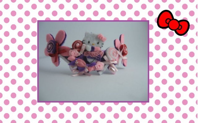 Cerchietto Hello Kitty con caramelle